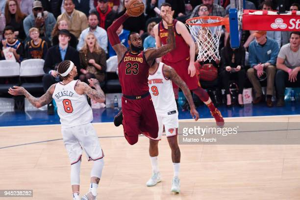 LeBron James of the Cleveland Cavaliers dunks the ball against Michael Beasley of the New York Knicks during the game at Madison Square Garden on...
