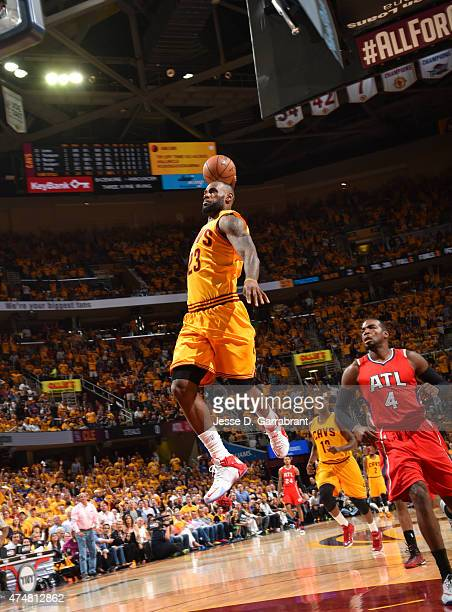 LeBron James of the Cleveland Cavaliers dunks the ball against the Atlanta Hawks at the Quicken Loans Arena During Game Four of the Eastern...