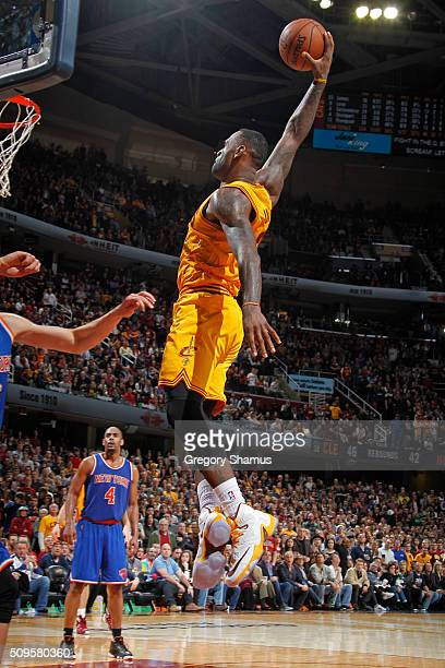 LeBron James of the Cleveland Cavaliers dunks the ball against the New York Knicks on December 23 2015 at Quicken Loans Arena in Cleveland Ohio NOTE...