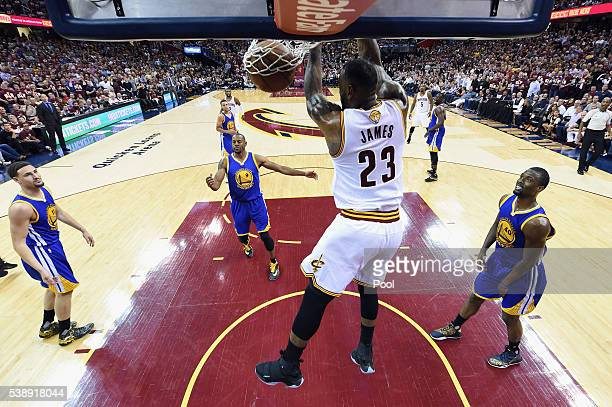 LeBron James of the Cleveland Cavaliers dunks the ball against the Golden State Warriors in Game 3 of the 2016 NBA Finals at Quicken Loans Arena on...