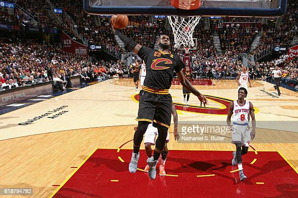 LeBron James of the Cleveland Cavaliers dunks the ball against the New York Knicks on October 25 2016 at Quicken Loans Arena in Cleveland Ohio NOTE...