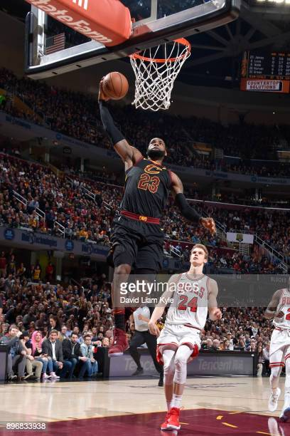 LeBron James of the Cleveland Cavaliers dunks the ball against the Chicago Bulls on December 21 2017 at Quicken Loans Arena in Cleveland Ohio NOTE TO...