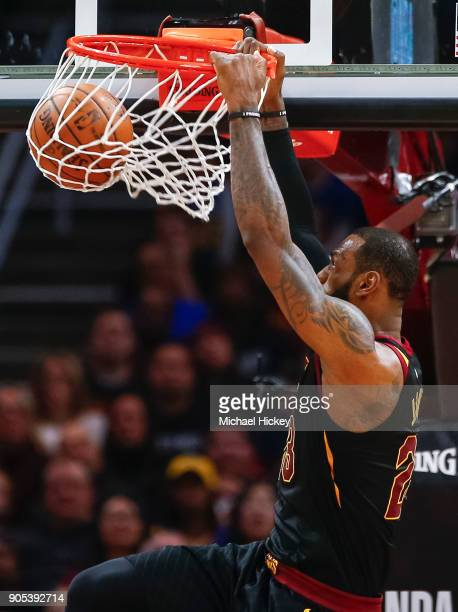 LeBron James of the Cleveland Cavaliers dunks the ball against the Golden State Warriors at Quicken Loans Arena on January 15 2018 in Cleveland Ohio...
