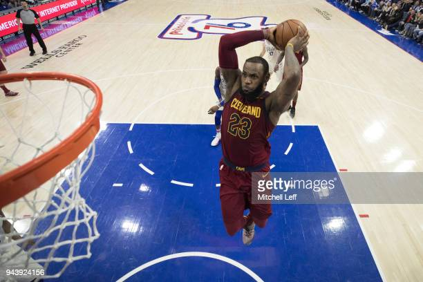 LeBron James of the Cleveland Cavaliers dunks the ball against the Philadelphia 76ers at the Wells Fargo Center on April 6 2018 in Philadelphia...