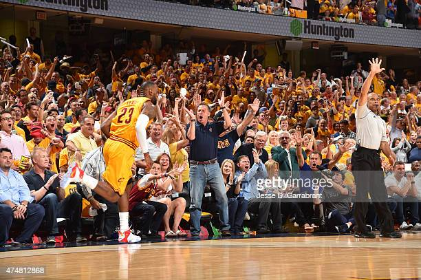 LeBron James of the Cleveland Cavaliers dunks the ball and the fans react after the play against the Atlanta Hawks at the Quicken Loans Arena During...