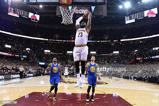 LeBron James of the Cleveland Cavaliers dunks the ball during the first half against the Golden State Warriors in Game 6 of the 2016 NBA Finals at...