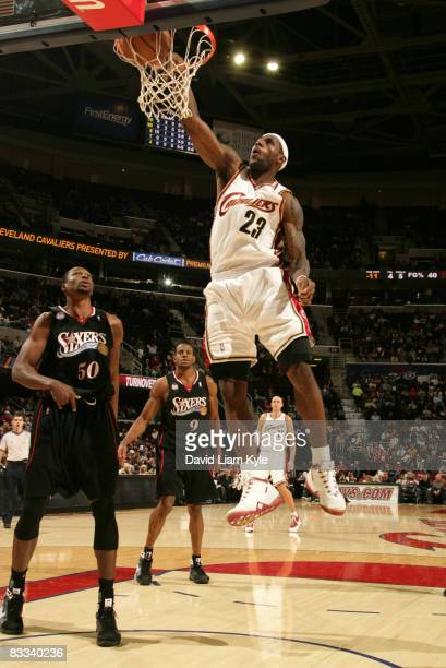 LeBron James of the Cleveland Cavaliers dunks the ball in front of Theo Ratliff and Andre Iguodala of the Philadelphia 76ers at The Quicken Loans...