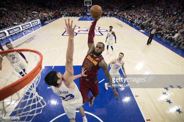 LeBron James of the Cleveland Cavaliers dunks the ball over Ersan Ilyasova of the Philadelphia 76ers in the fourth quarter at the Wells Fargo Center...