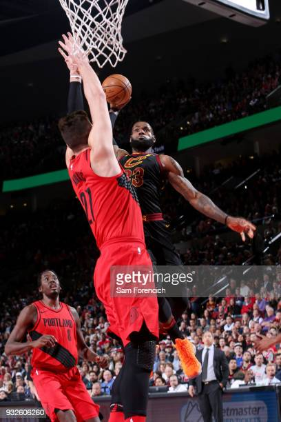 LeBron James of the Cleveland Cavaliers dunks the ball while guarded by Jusuf Nurkic of the Portland Trail Blazers on March 15 2018 at the Moda...