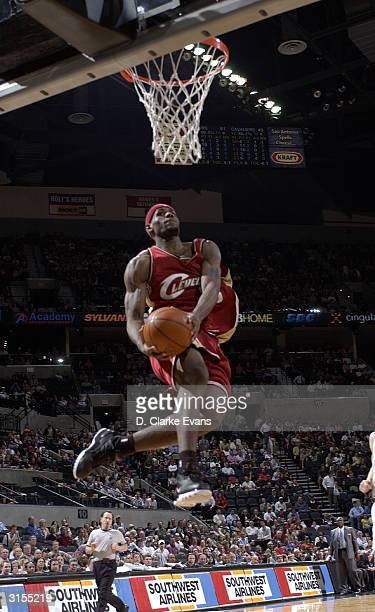 LeBron James of the Cleveland Cavaliers flies in for a dunk against the San Antonio Spurs March 29 2004 at the SBC Center in San Antonio Texas NOTE...