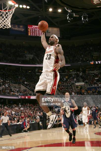 LeBron James of the Cleveland Cavaliers flies in for the dunk trailed by Mike Bibby of the Atlanta Hawks in Game One of the Eastern Conference...