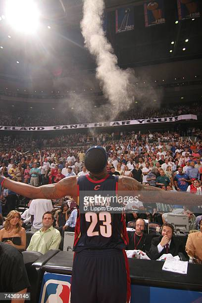LeBron James of the Cleveland Cavaliers follows his custom and throws up powder before a game against the Detroit Pistons in Game Five of the Eastern...