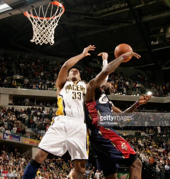 LeBron James of the Cleveland Cavaliers fouls Danny Granger of the Indiana Pacers and Granger then hit one of his free throws to give the Pacers the...
