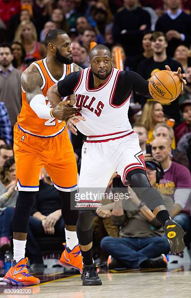 LeBron James of the Cleveland Cavaliers fouls Dwyane Wade of the Chicago Bulls during the second half at Quicken Loans Arena on January 4 2017 in...
