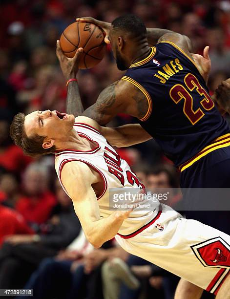 LeBron James of the Cleveland Cavaliers fouls Mike Dunleavy of the Chicago Bulls in the finals seconds in Game Four of the Eastern Conference...