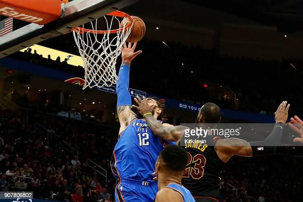 LeBron James of the Cleveland Cavaliers fouls Steven Adams of the Oklahoma City Thunder during the second quarter at Quicken Loans Arena on January...