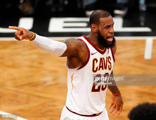 LeBron James of the Cleveland Cavaliers gestures during an NBA basketball game against the Brooklyn Nets on March 25 2018 at Barclays Center in the...