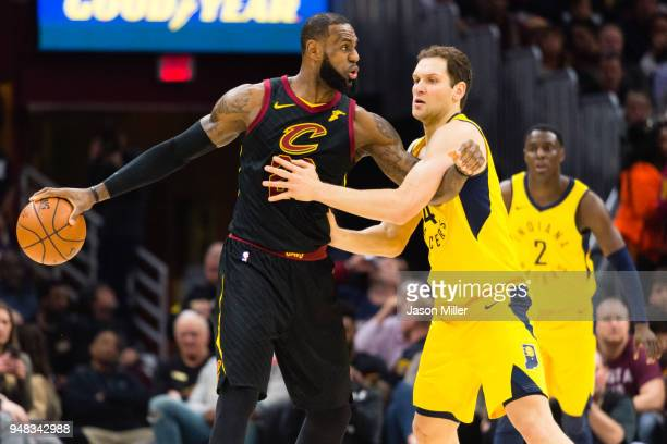 LeBron James of the Cleveland Cavaliers get tangled up with Bojan Bogdanovic of the Indiana Pacers during the first half of Game 2 of the first round...
