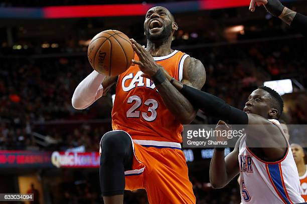 LeBron James of the Cleveland Cavaliers gets fouled by Victor Oladipo of the Oklahoma City Thunder on his way to the basket in the second half at...