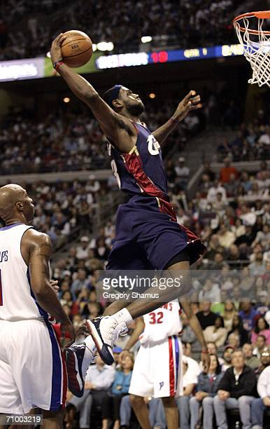 LeBron James of the Cleveland Cavaliers gets in for a dunk between Chauncey Billups and Richard Hamilton of the Detroit Pistons in game seven of the...