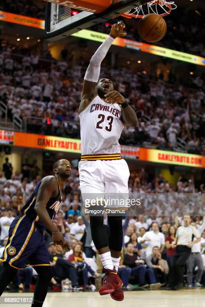 LeBron James of the Cleveland Cavaliers gets in for a dunk next to CJ Miles of the Indiana Pacers during the second half in Game One of the Eastern...