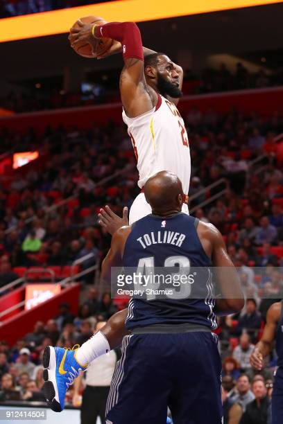 LeBron James of the Cleveland Cavaliers gets in for a first half dunk past Blake Griffin of the Detroit Pistons at Little Caesars Arena on January 30...