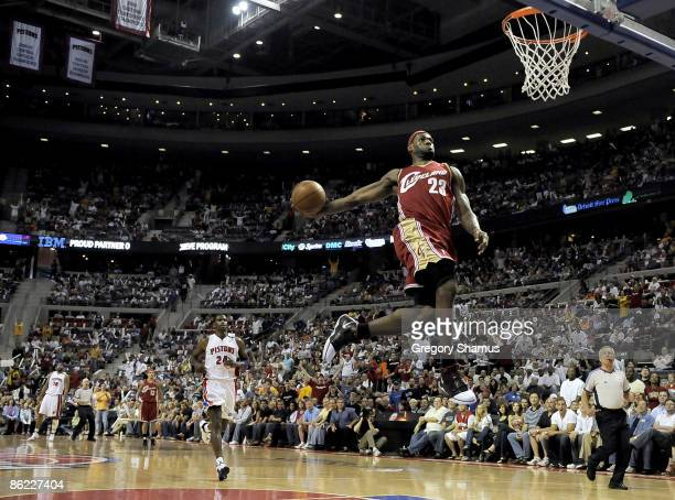 LeBron James of the Cleveland Cavaliers gets in for a first quarter break away dunk in front of Antonio McDyess of the Detroit Pistons in Game Four...