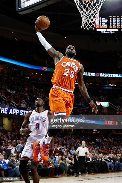 LeBron James of the Cleveland Cavaliers gets to the basket for a second half dunk in front of Jerami Grant of the Oklahoma City Thunder at Quicken...