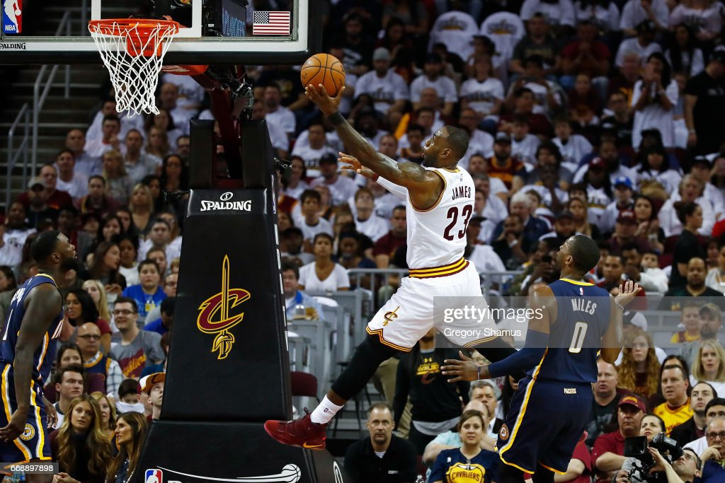 LeBron James #23 of the Cleveland Cavaliers gets to the basket past CJ Miles #0 of the Indiana Pacers during the first half in Game One of the Eastern Conference Quarterfinals during the 2017 NBA Playoffs at Quicken Loans Arena on April 15, 2017 in Cleveland, Ohio.