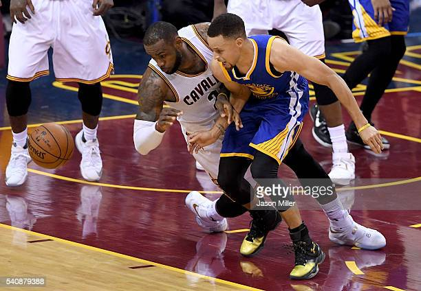 LeBron James of the Cleveland Cavaliers goes after the ball against Stephen Curry of the Golden State Warriors in Game 6 of the 2016 NBA Finals at...