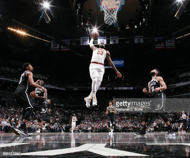 LeBron James of the Cleveland Cavaliers goes for a dunk against the Brooklyn Nets on October 25 2017 at Barclays Center in Brooklyn New York NOTE TO...