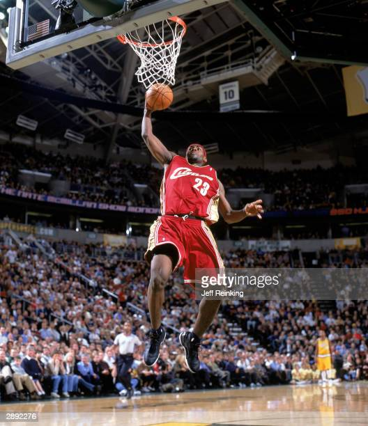 LeBron James of the Cleveland Cavaliers goes for a dunk during the NBA game against the Seattle Sonics at Key Arena on January 13 2004 in Seattle...