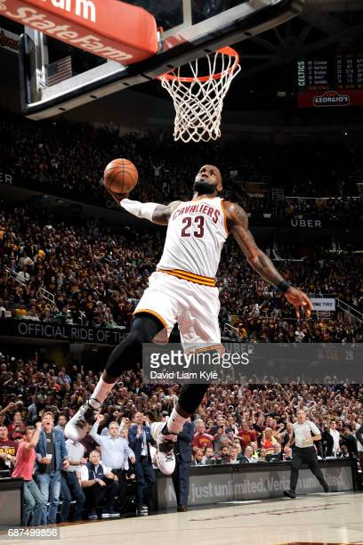 LeBron James of the Cleveland Cavaliers goes for a dunk during the game against the Boston Celtics in Game Four of the Eastern Conference Finals of...