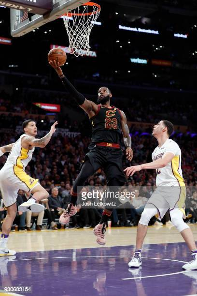 LeBron James of the Cleveland Cavaliers goes for a layup against Lonzo Ball and Kyle Kuzma of the Los Angeles Lakers during the game at Staples...