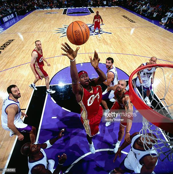 LeBron James of the Cleveland Cavaliers goes for a rebound against the Sacramento Kings during the NBA game at the Arco Arena on October 29 2003 in...