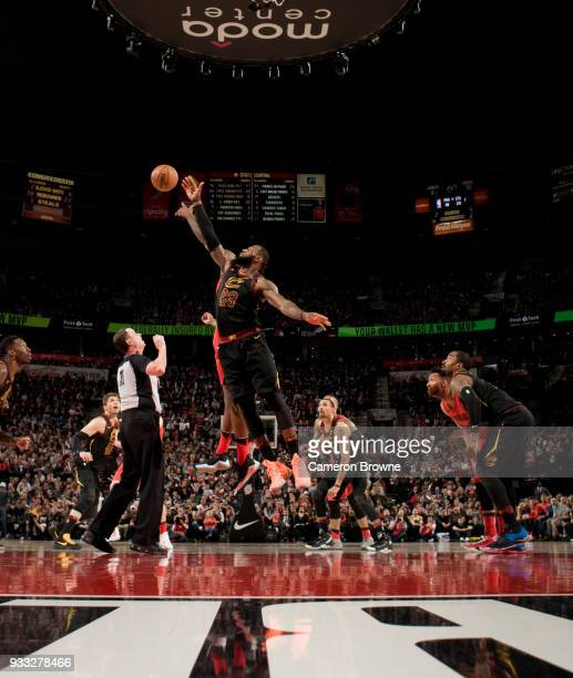 LeBron James of the Cleveland Cavaliers goes for the jump ball against the Portland Trail Blazers on March 15 2018 at the Moda Center in Portland...