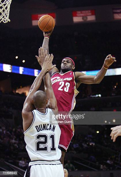 LeBron James of the Cleveland Cavaliers goes in for a slam dunk over Tim Duncan of the San Antonio Spurs on November 3, 2006 at the AT&T Center in...
