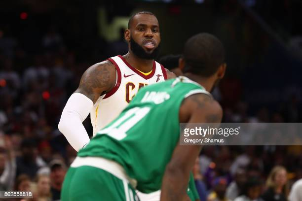LeBron James of the Cleveland Cavaliers goes to greet Kyrie Irving of the Boston Celtics prior to playing at at Quicken Loans Arena on October 17...