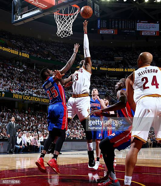 LeBron James of the Cleveland Cavaliers goes to the basket against Reggie Bullock of the Detroit Pistons in Game Two of the Eastern Conference...