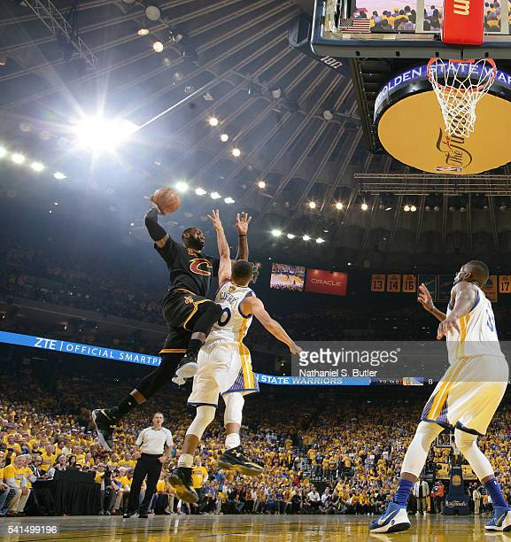 LeBron James of the Cleveland Cavaliers goes to the basket against Stephen Curry of the Golden State Warriors in Game Seven of the 2016 NBA Finals on...
