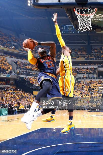 LeBron James of the Cleveland Cavaliers goes to the basket against Paul George of the Indiana Pacers in the second quarter of Game Five of the...