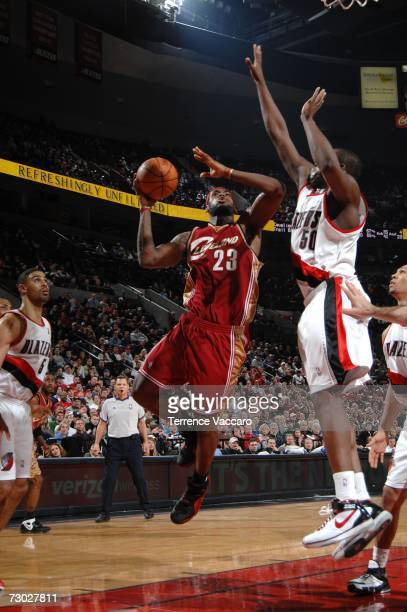 LeBron James of the Cleveland Cavaliers goes to the basket against Zach Randolph of the Portland Trail Blazers on January 17 2007 at the Rose Garden...
