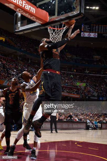 LeBron James of the Cleveland Cavaliers goes to the basket against the Golden State Warriors on January 15 2018 at Quicken Loans Arena in Cleveland...