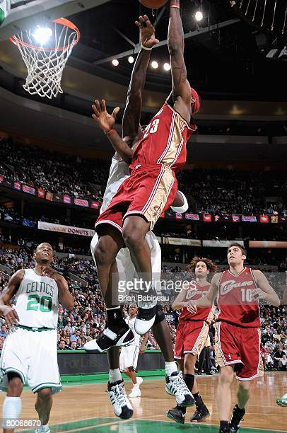LeBron James of the Cleveland Cavaliers goes to the basket and scores his 10000th point over Kevin Garnett of the Boston Celtics during the game on...