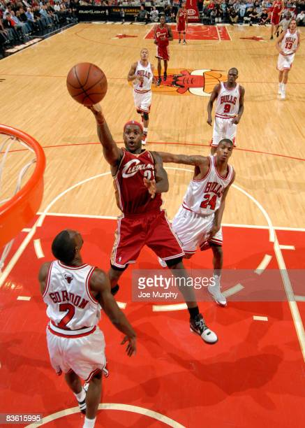 Lebron James of the Cleveland Cavaliers goes to the basket over Ben Gordon and Tyrus Thomas of the Chicago Bulls during the NBA game on November 8,...