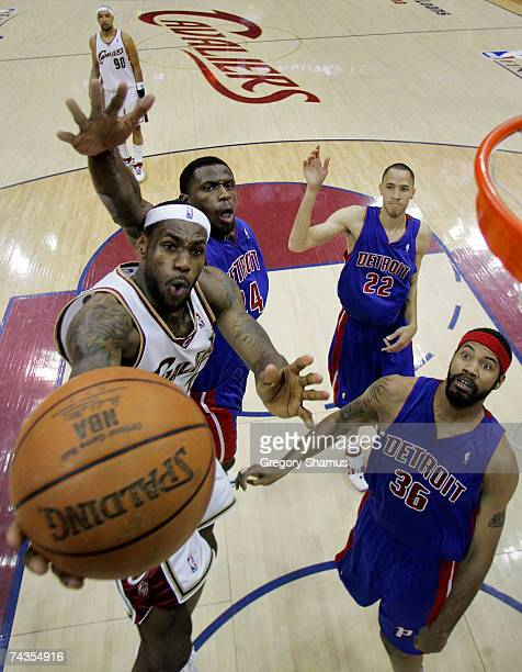 LeBron James of the Cleveland Cavaliers goes to the hoop against Antonio McDyess and Rasheed Wallace of the Detroit Pistons in Game Four of the...