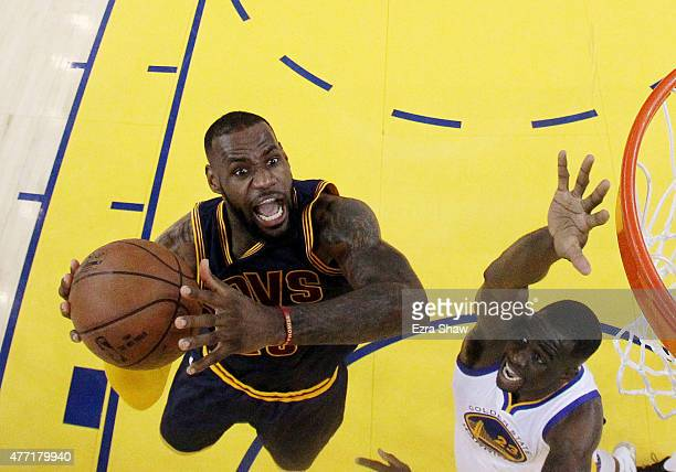 LeBron James of the Cleveland Cavaliers goes up against Draymond Green of the Golden State Warriors in the first half during Game Five of the 2015...