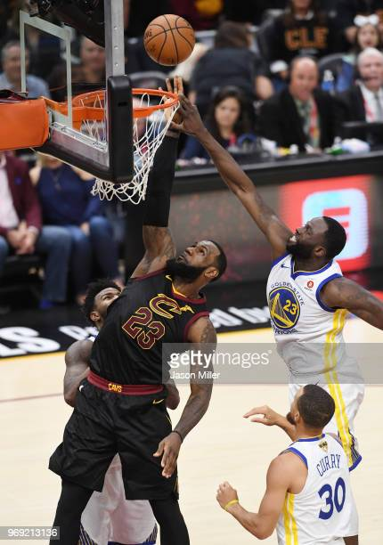 LeBron James of the Cleveland Cavaliers goes up against Draymond Green of the Golden State Warriors during Game Three of the 2018 NBA Finals at...