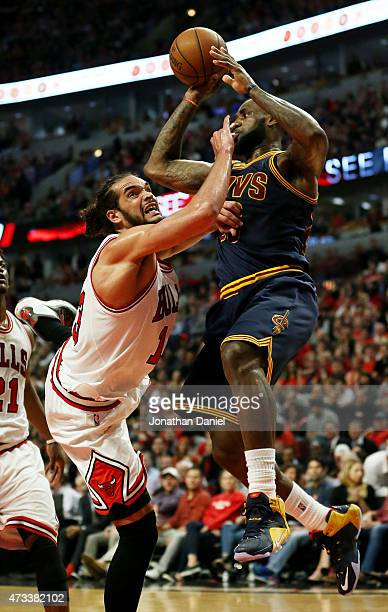 LeBron James of the Cleveland Cavaliers goes up against Joakim Noah of the Chicago Bulls in the second quarter during Game Six of the Eastern...