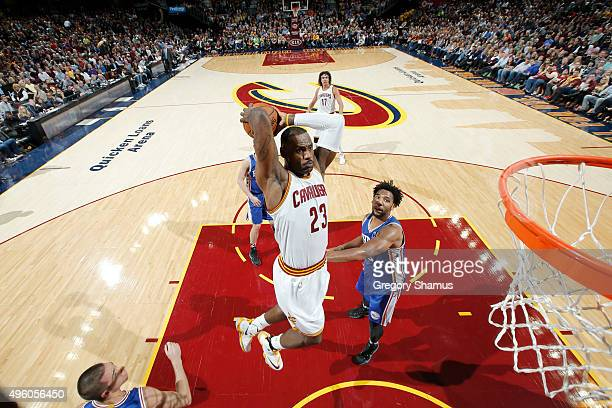LeBron James of the Cleveland Cavaliers goes up for a dunk against the Philadelphia 76ers on November 6 2015 at Quicken Loans Arena in Cleveland Ohio...